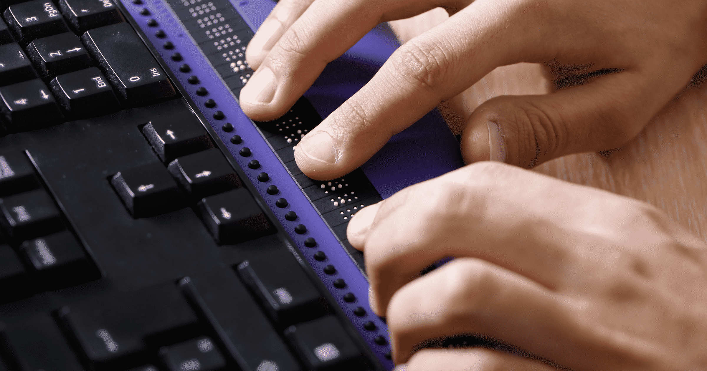 Person using Braille adaptive technology. Why Should your Website be ADA Compliant Blog